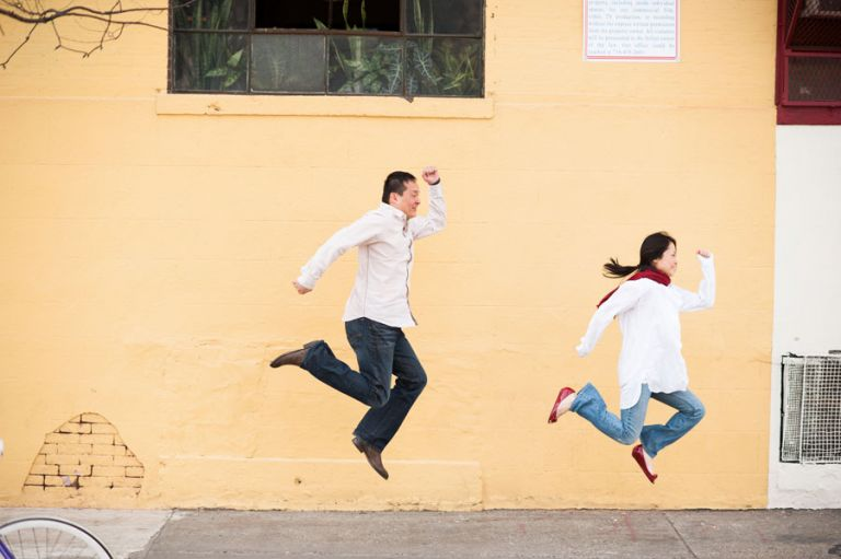 Lisa and Kai jump simultaneously during their engagement session in Williamsburg, NY with Ben Lau Photography.