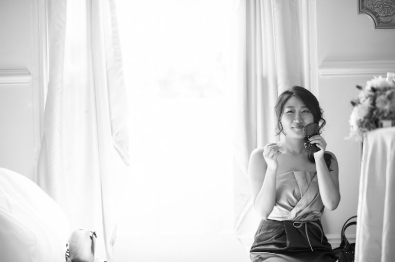 Bridesmaid gets ready before Hae Yoon and Bernards wedding day at Snug Harbor in Staten Island. Captured by awesome NYC wedding photographer Ben Lau.