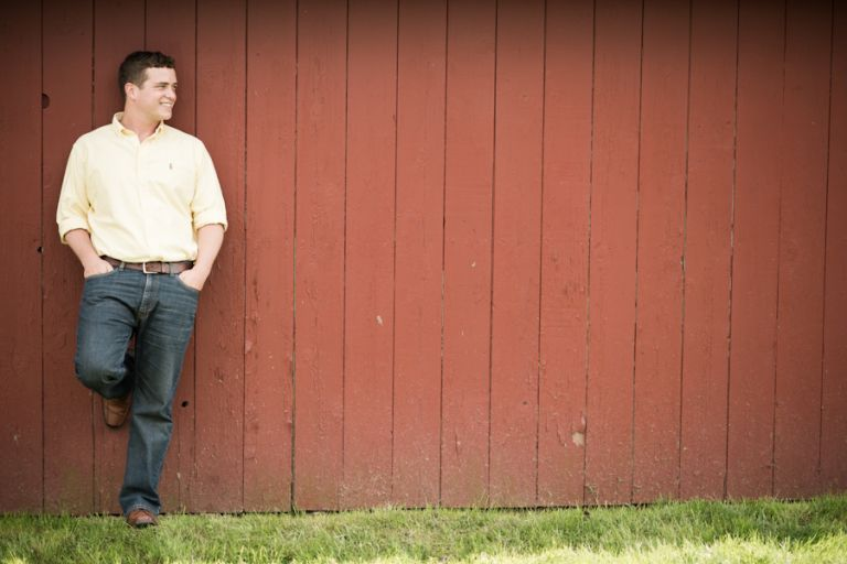 Rob poses along a barn wall during his engagement session with awesome NJ wedding photographer Ben Lau.