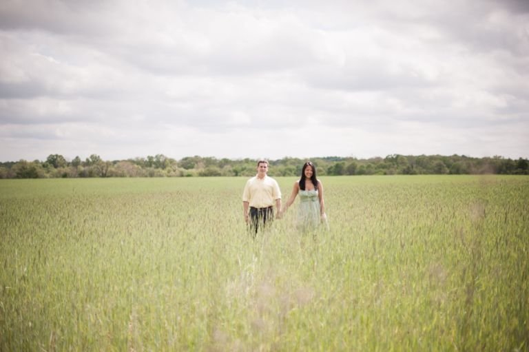 Kelly and Rob pose in a vast field of tall grass during their engagement session in NJ Wine Country with awesome Central NJ Wedding Photographer Ben Lau.