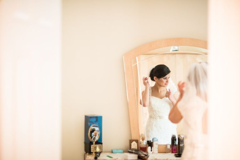 Bride Magi gets ready at her home in Little Falls for her wedding day in Jersey City, NJ. Captured by awesome New Jersey wedding photographer Ben Lau.