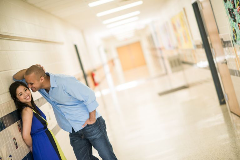 Maricar and Izaak pose in a school hallway during their engagement session with Northern Virginia wedding photographer Ben Lau.