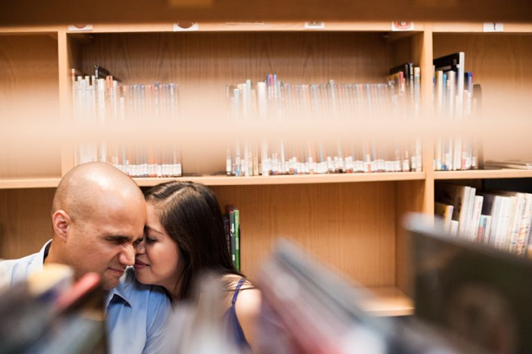 Maricar and Izaak share a in library during their engagement session with Northern Virginia wedding photographer Ben Lau.