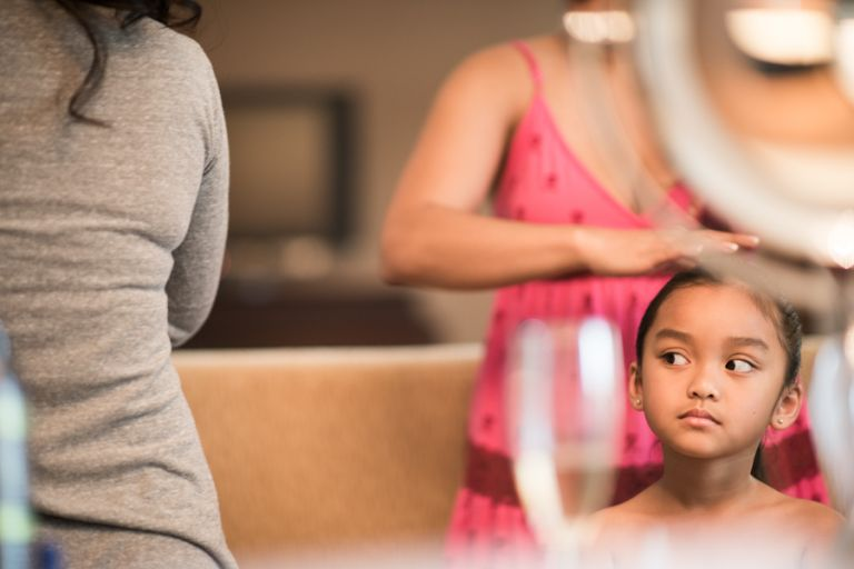 Flower girl gets her hair done during her prep at the Gaylord National Resort in Washington DC. Captured be awesome NJ wedding photographer Ben Lau.