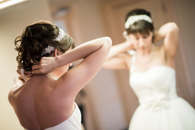 Bride gets ready on her wedding day at the Bayard Cutting Arboretum on Long Island, NY. Captured by awesome NJ wedding photographer Ben Lau.
