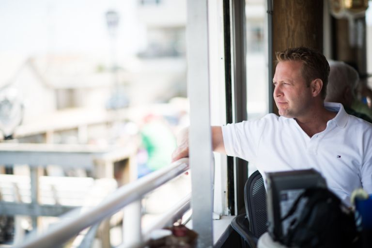 Gregg looks out to the bay in Long Beach Island, NJ during their engagement session with Ben Lau Photography.
