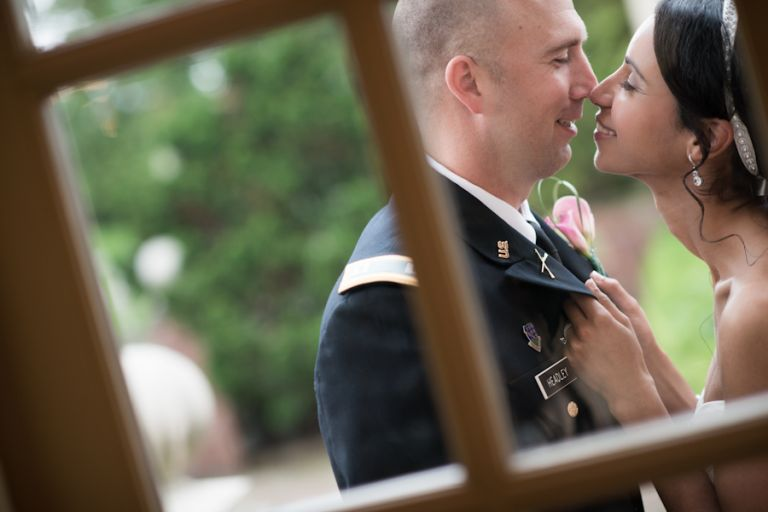 Bride and groom share a kiss on their wedding day at The Manor in West Orange, NJ. Captured by awesome NJ wedding photographer Ben Lau.