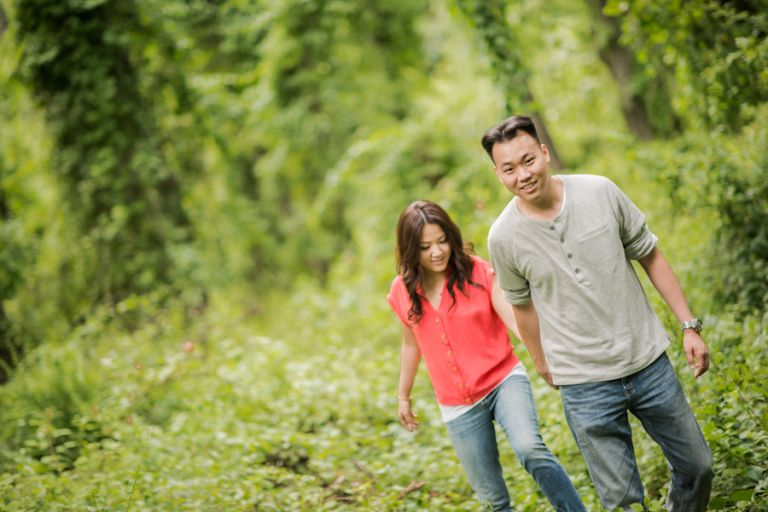 Sally and Terence walk through the woods in Bear Mountain, NY. Captured by awesome NJ wedding photographer Ben Lau.