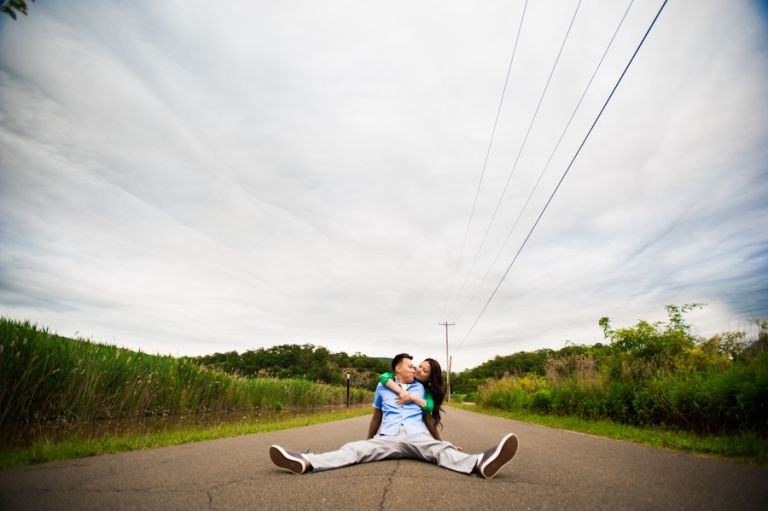 Sally and Terence pose by a roadside during their engagement session with awesome NJ wedding photographer Ben Lau.
