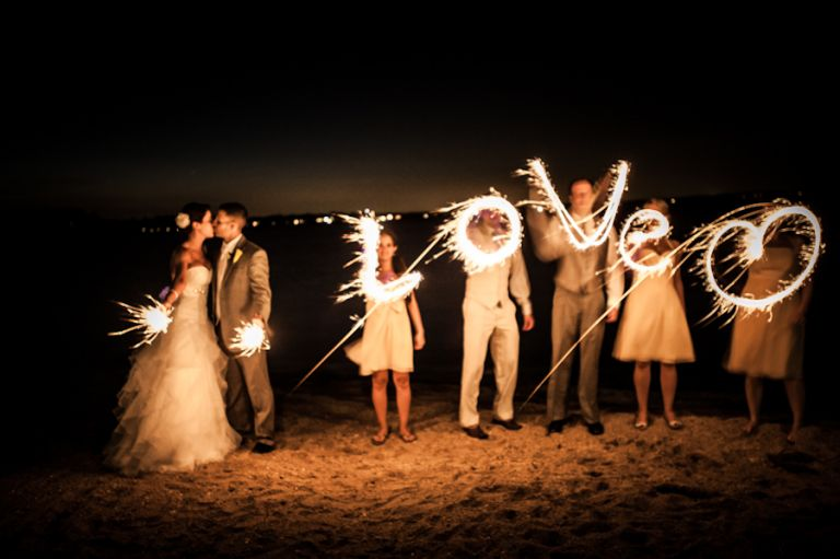 Sparklers spell words during a wedding at Herrington on the Bay in Chesapeake Beach, MD. Captured by awesome NJ wedding photographer Ben Lau.