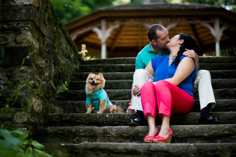 Dog watches as Jenny and Jeff share a kiss during their engagement session at a park near Philadelphia, PA. Captured by awesome NJ wedding photographer Ben Lau.