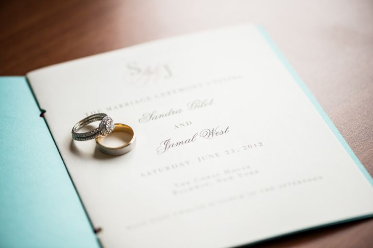 Rings and wedding program for Sandra and Jamal's wedding at the Coral House in Baldwin, NY. Captured by awesome NJ wedding photographer Ben Lau.