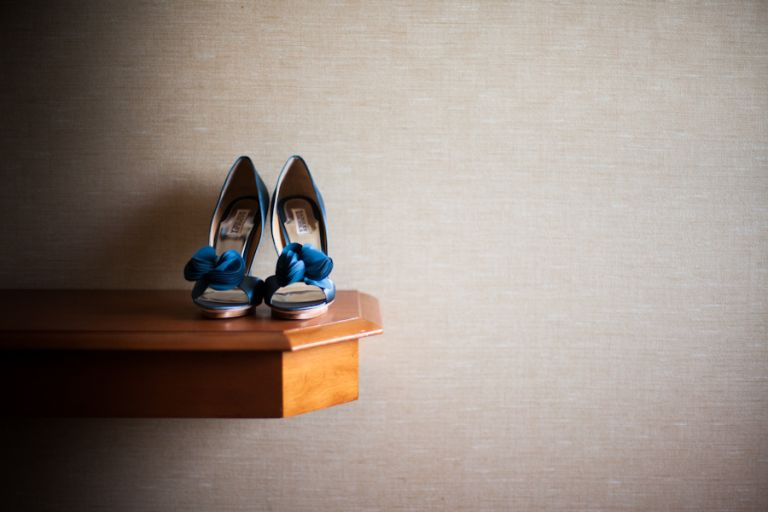 Bride's shoes before her wedding ceremony at the Coral House in Baldwin, NY. Captured by awesome NJ wedding photographer Ben Lau.