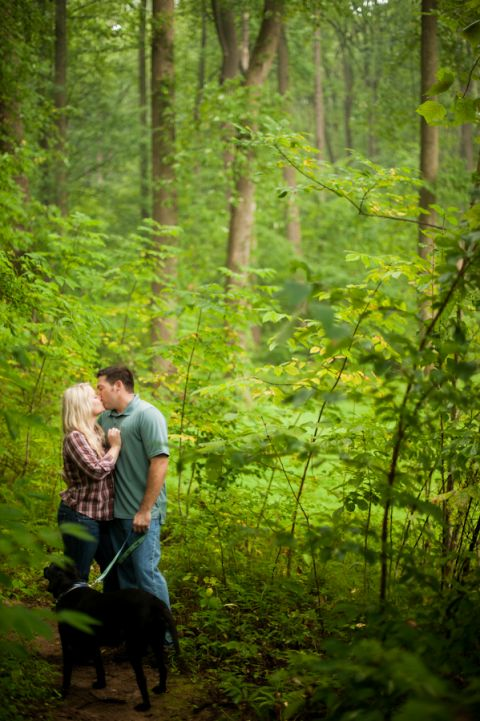 Fran and Joe share a kiss during their engagement session at the Loch Raven Resevoir in Baltimore, MD with Ben Lau Photography.
