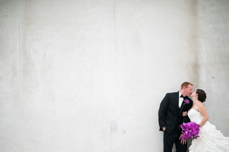 Bride and Groom pose against a wall during their bridal portraits in New Brunswick, NJ. Captured by best NJ wedding photographer, Ben Lau.