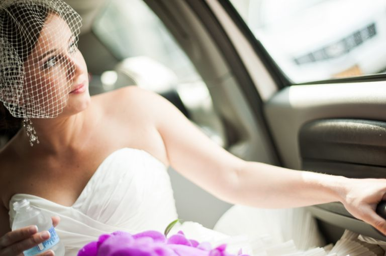 Bride sits in the limo on her way to her wedding ceremony in New Brunswick, NJ. Captured by best NJ wedding photographer, Ben Lau.