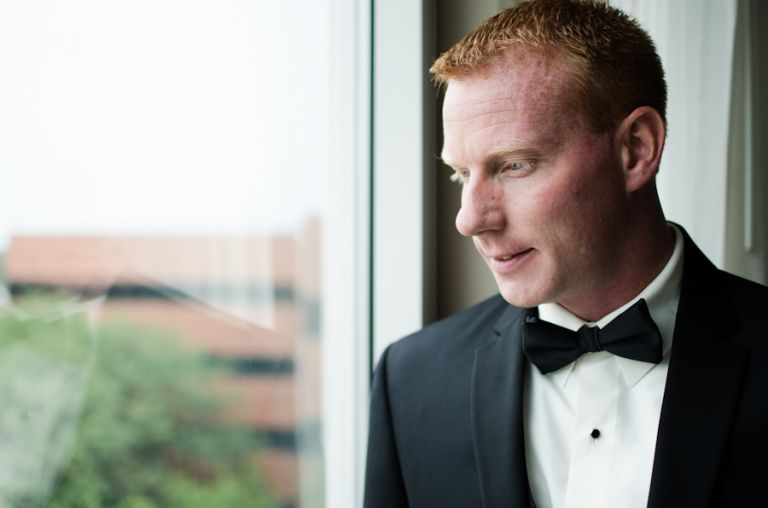 Groom poses during prep in New Brunswick, NJ. Captured by best NJ wedding photographer, Ben Lau.