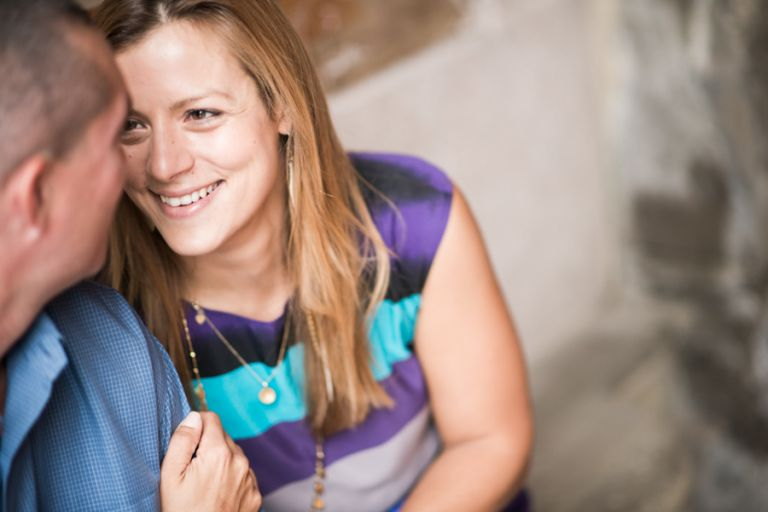 Erin smiles at Tim during their engagement session in Central Park with Ben Lau Photography.