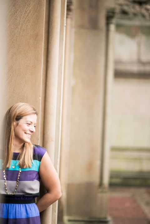 Erin poses in the archway during her engagement session in Central Park with Ben Lau Photography.