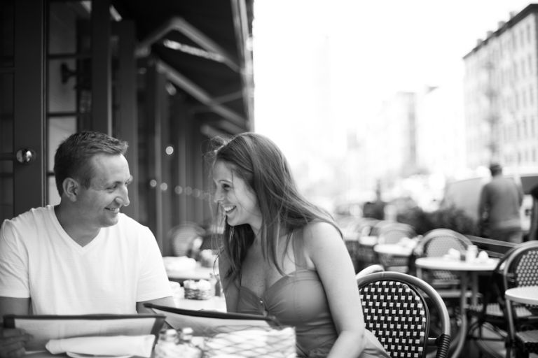 Kathleen and Tim take a break during their engagement session in New York City. Captured by Ben Lau Photography.