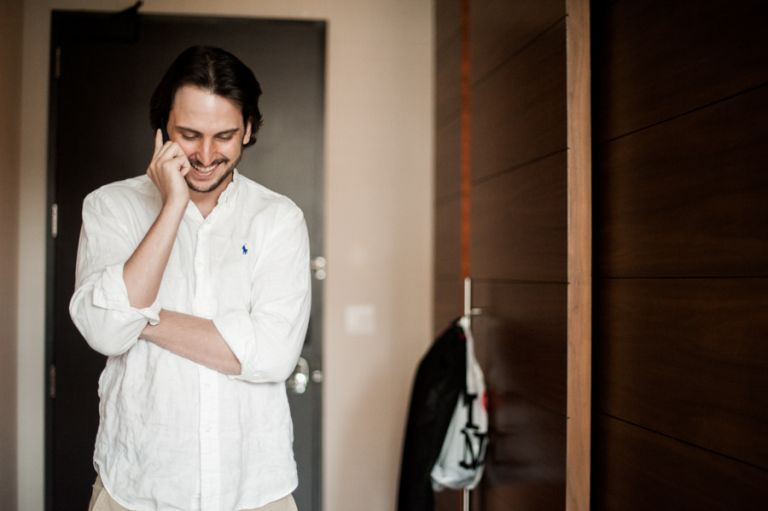 Groom talks on the phone on the morning of his wedding at the Eventi hotel in New York City. Captured by northern NJ wedding photographer Ben Lau.