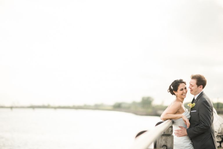 Negar and Jason pose for their bridal portraits on their wedding day at the Liberty House in Jersey City, NJ. Captured by northern NJ wedding photographer Ben Lau.