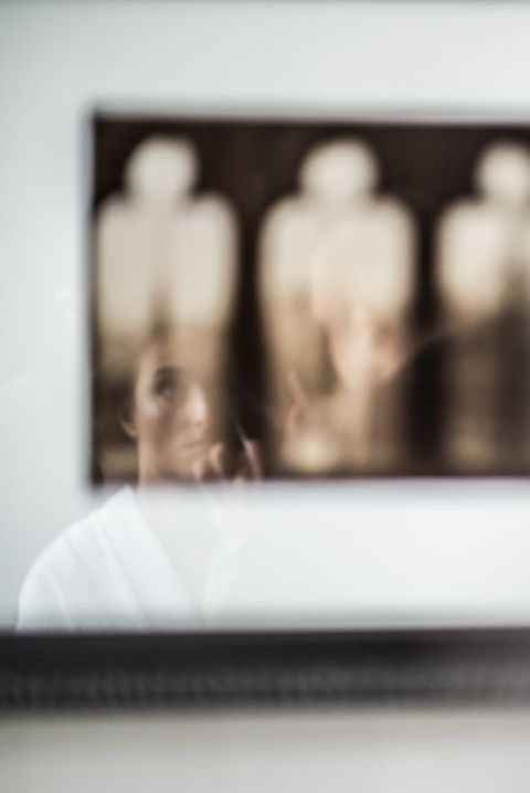 Bride's reflection during prep for her wedding at the Eventi Hotel in New York City. Captured by NYC wedding photographer Ben Lau.