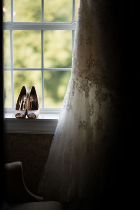 Bride's wedding shoes on the morning of her wedding at The Manor in West Orange, NJ. Captured by northern NJ wedding photographer Ben Lau.