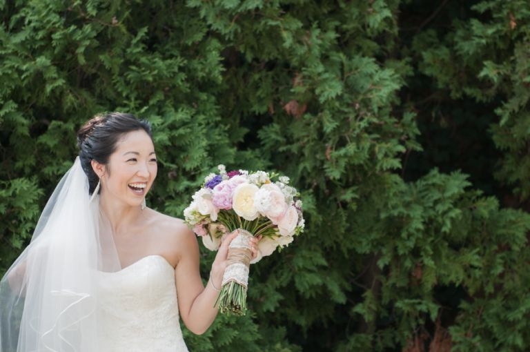 Bride Sarah laughs during portraits on the morning of her wedding day at The Manor in West Orange, NJ. Captured by northern nj wedding photographer Ben Lau.
