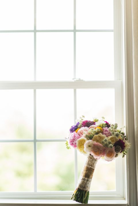 Bride's flowers sit on a window on the morning of her wedding at The Manor in West Orange, NJ. Captured by northern NJ wedding photographer Ben Lau.