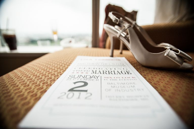 Invitation and shoes for a wedding at the Baltimore Museum of Industry in Baltimore, MD. Captured by northern NJ wedding photographer Ben Lau.