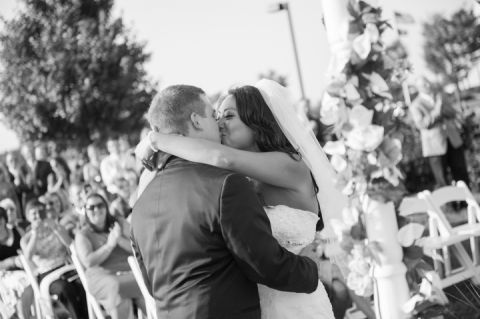 First kiss at Kelly and Rob's Neshanic Valley Golf Course wedding in Neshanic Station, NJ. Captured by northern NJ wedding photographer Ben Lau.