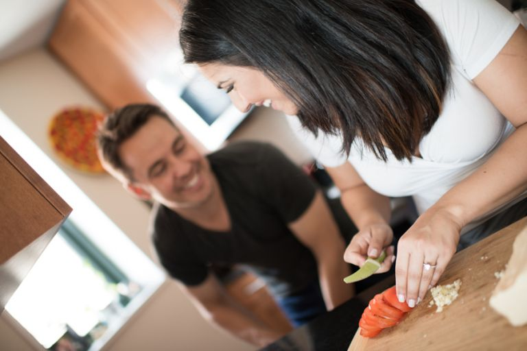 Amedea and Ray cook some pasta during their indoor engagement session with NYC wedding photographer Ben Lau.