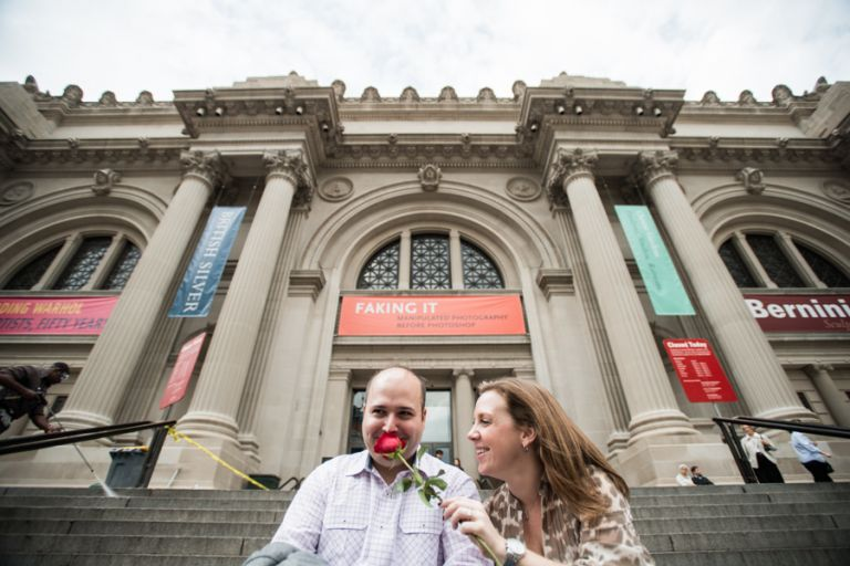 Katie and Craig pose during their engagement session in front of the Metropolitan Museum with NYC wedding photographer Ben Lau.