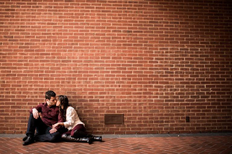 Christine and Chalita pose along a wall in historic Georgetown during their engagement session with DC wedding photographer Ben Lau.