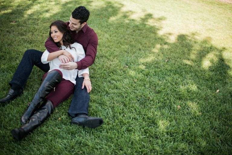 Christine and Chalita lay on the grass in historic Georgetown during their engagement session with DC wedding photographer Ben Lau.