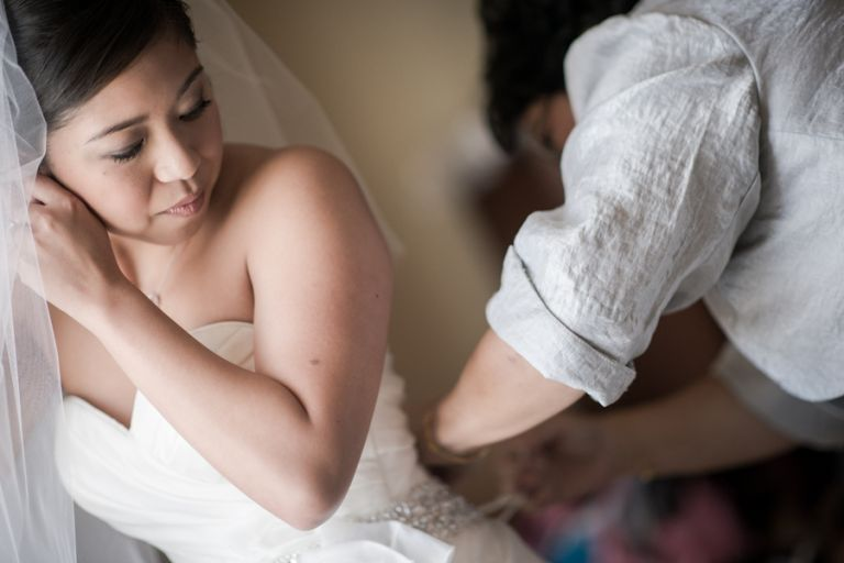 Bride gets ready for her wedding day at the Marriott Crystal City in Arlington VA. Caputred by Northern Virginia wedding photographer Ben Lau.