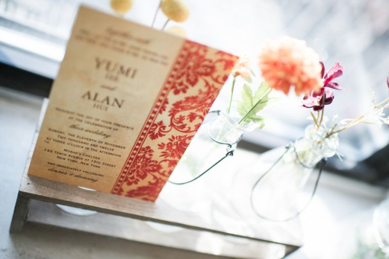 Stationery and flowers for a wedding at Morans in Chelsea, NY. Captured by NYC wedding photographer Ben Lau.