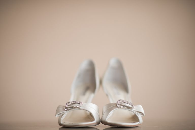 Bride's shoes on her wedding day at Clarks Landing in Point Pleasant, NJ. Captured by northern NJ wedding photographer Ben Lau.