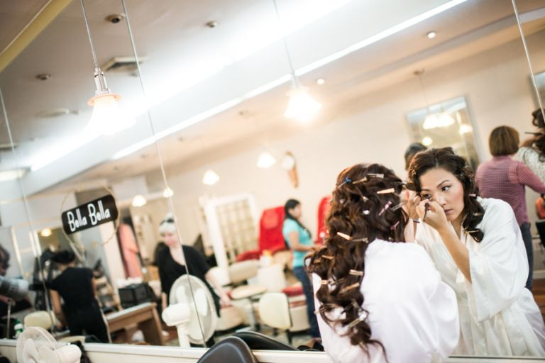 Bride preps for her wedding at the VIP Country Club in Westchester, NY. Captured by NYC wedding photographer Ben Lau.