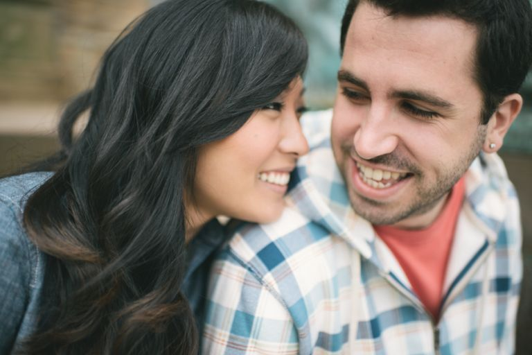 Julia and Jeff smile during their engagement session at Princeton University.