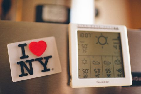Wedding day fridge magnets at the Liberty House in Jersey City, NJ. Captured by NYC wedding photographer Ben Lau.