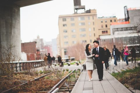 Couple walk along the High Line during their engagement session in NYC. Captured by NYC wedding photographer Ben Lau.