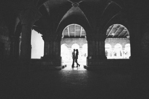 Lisa and Cyrus pose during their engagement session inside an archway with NYC wedding photographer Ben Lau.