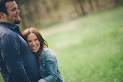 Couple shares a laugh during their engagement session in Morristown with NJ wedding photographer Ben Lau.