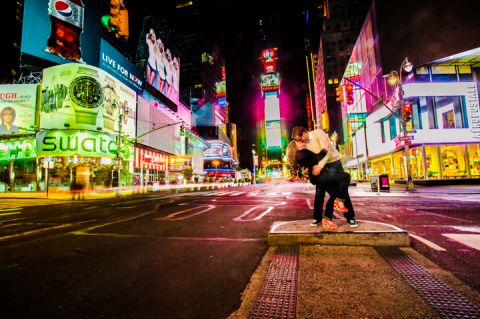 Nick dips Karina on a corner in Times Square. Captured by NYC wedding photographer Ben Lau.