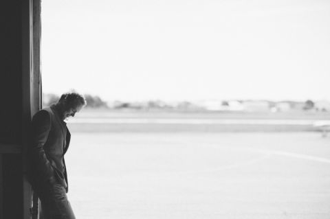 Groom solo during his engagement session at an airfield in Philadelphia, PA. Captured by NJ wedding photographer Ben Lau.