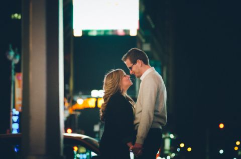 Karina and Nick pose on a street corner in Times Square during their engagement session with NYC wedding photographer Ben Lau.