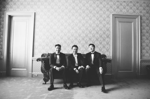 Groomsmen pose for a portrait at the Hempstead House in Sands Point Preserve, Long Island. Captured by NYC wedding photographer Ben Lau.