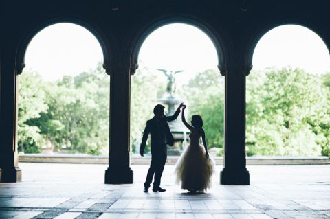 Bride and groom dance under the archways at Central Park during their bridal session with NYC wedding photographer Ben Lau.